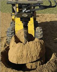Robinsons rents post hole digger attachments for the Toro Dingo